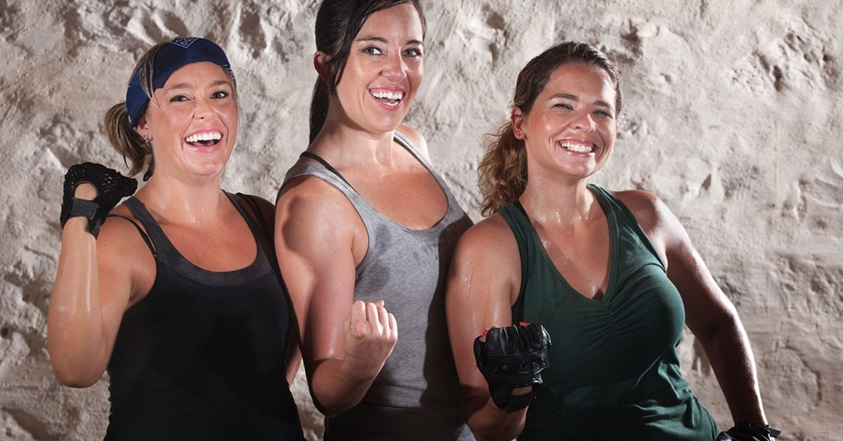15934465 - three friends flexing their muscles in boot camp style workout